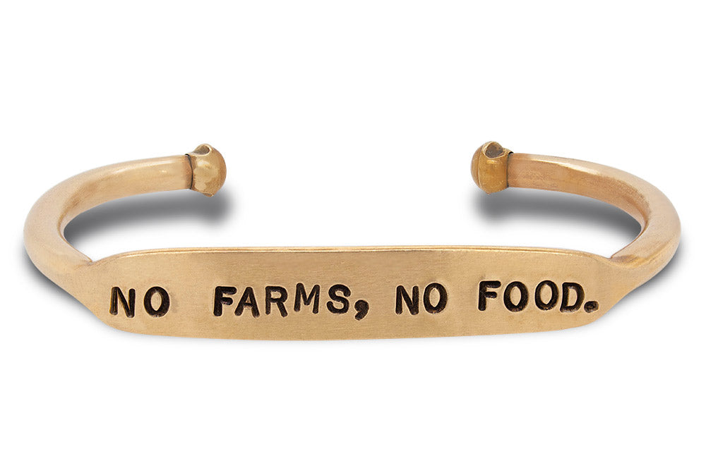 "Load image into Gallery viewer, Hand stamped, solid brass cuff that says ""no farms, no food."""