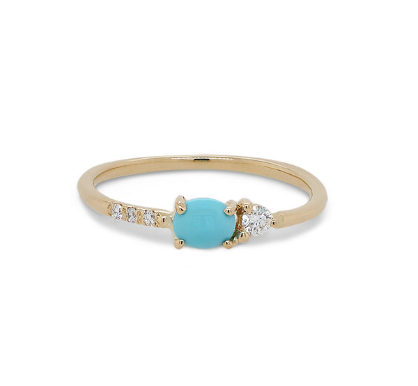 Front view of asymmetrical cabochon turquoise ring with 3 small diamonds and 1 medium size diamond.