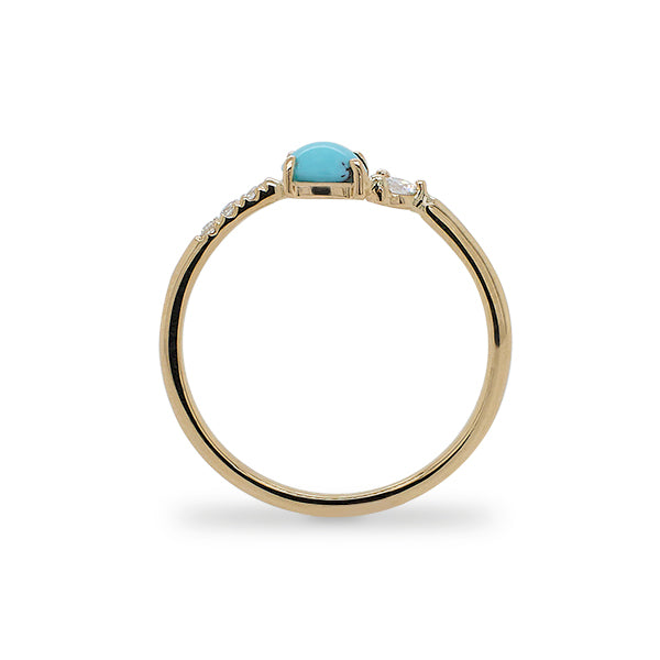 Side view of asymmetrical cabochon turquoise ring with 3 small diamonds and 1 medium size diamond.