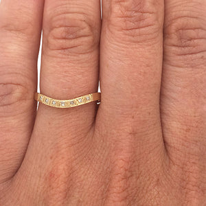 Load image into Gallery viewer, Princess cut diamond shadow band set in 14 kt yellow gold on left ring finger.
