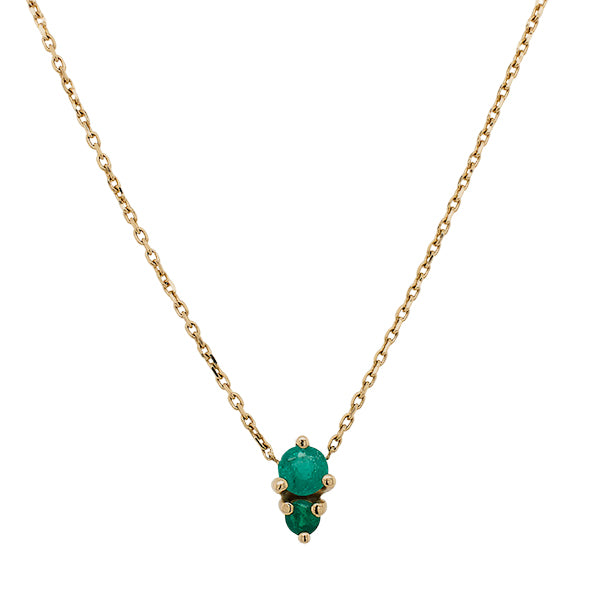 Front view of a double emerald necklace cast in a 14 kt yellow gold north south setting.