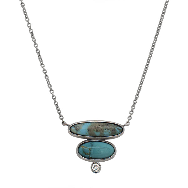 Front view of a double oval cut turquoise and 1 round cut diamond necklace set in 14 kt white gold.