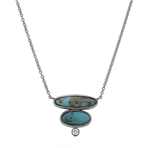 Load image into Gallery viewer, Front view of a double oval cut turquoise and 1 round cut diamond necklace set in 14 kt white gold.