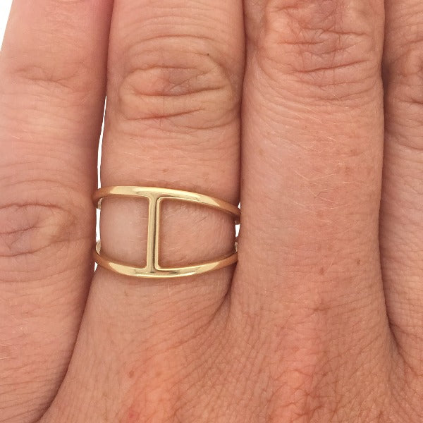 Double band bar ring cast in 14 kt yellow gold on left ring finger.