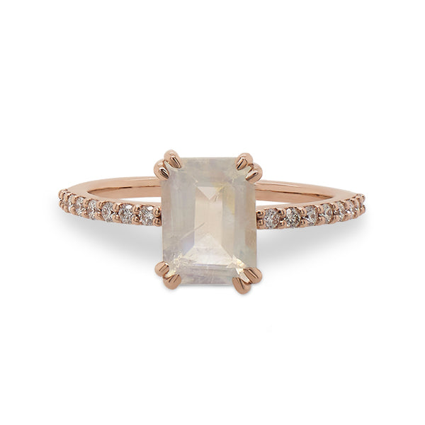 Front view of an emerald cut moonstone and diamond ring cast in 14 kt rose gold by King + Curated.