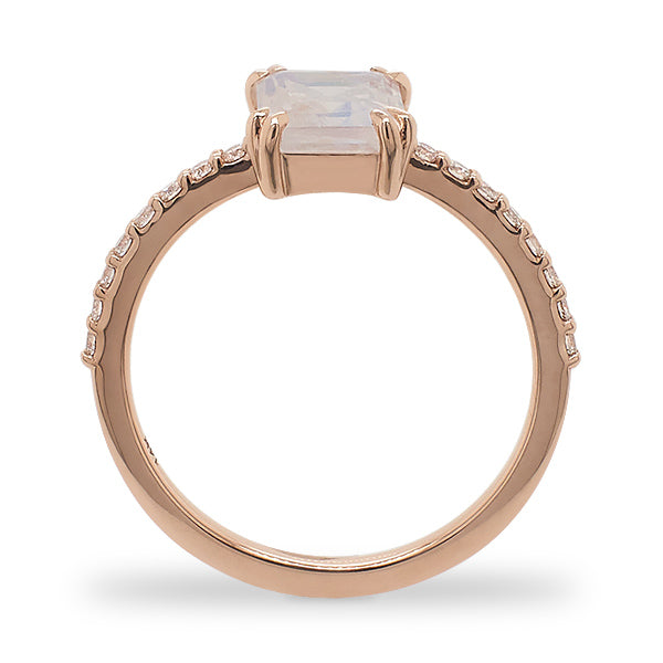 Load image into Gallery viewer, Side view of an emerald cut moonstone and diamond ring cast in 14 kt rose gold by King + Curated.