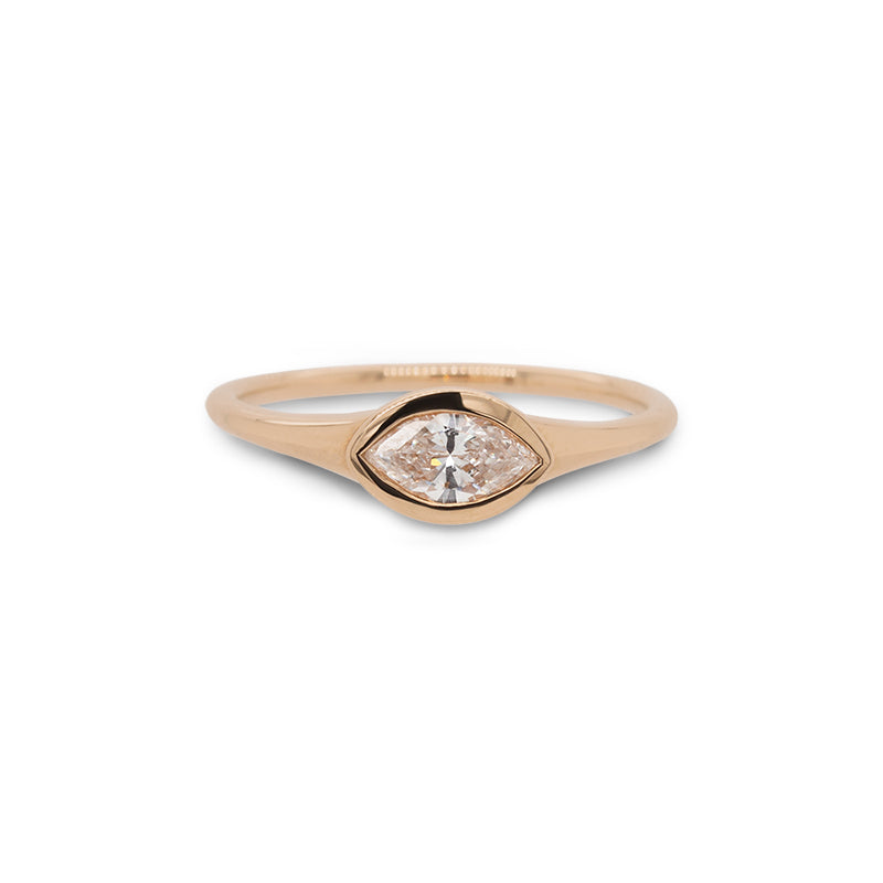 Front view of bezel set, marquise cut diamond ring set in 14 kt yellow gold. - King + Curated