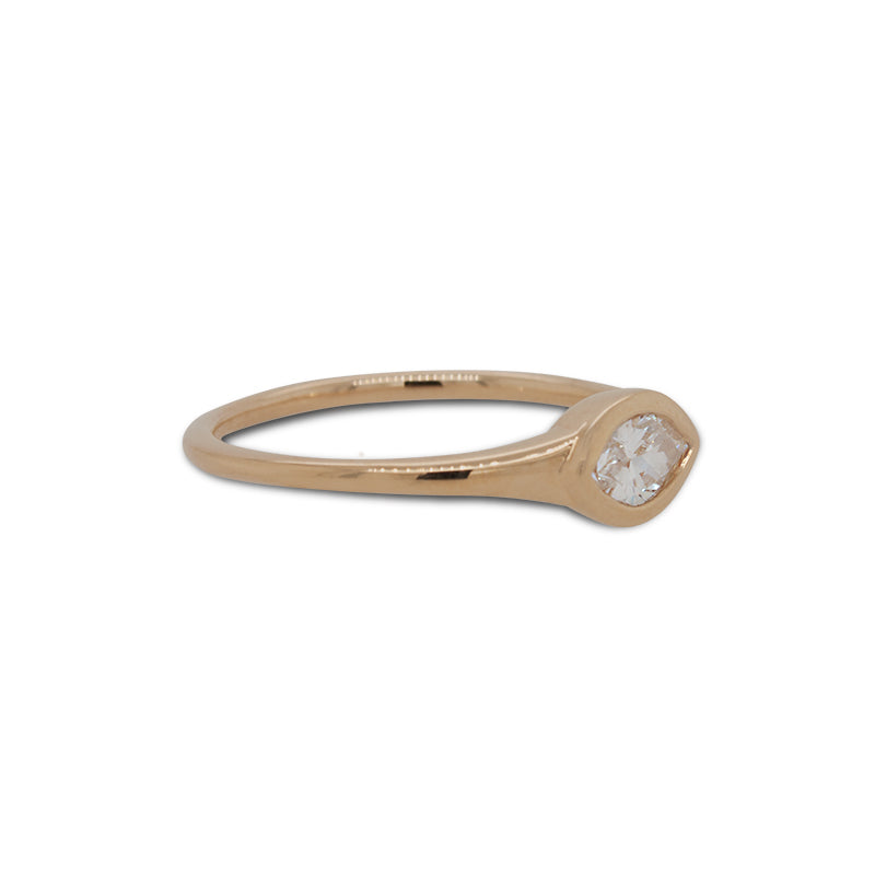 Load image into Gallery viewer, Side view of bezel set, marquise cut diamond ring set in 14 kt yellow gold.