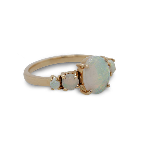 Load image into Gallery viewer, Side view of an asymmetrical opal and diamond ring cast in 14 kt yellow gold.