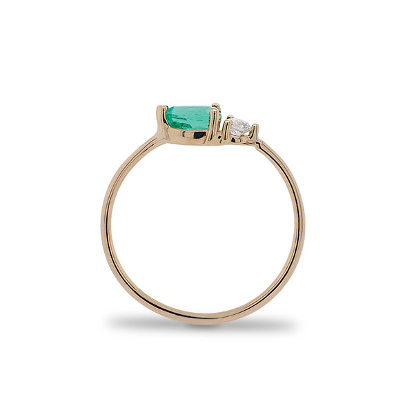 Load image into Gallery viewer, Side view of pear cut emerald and round diamond ring cast in 14 kt yellow gold.
