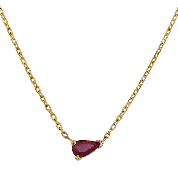 Front view of a pear cut, ruby necklace set in a 14 kt yellow gold V-end single base setting.