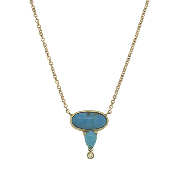 Front view of oval and pear cut turquoise and round diamond necklace cast in 14 kt yellow gold.