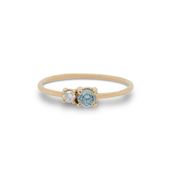Front view of round cut blue zircon and diamond ring cast in 14 kt yellow gold.