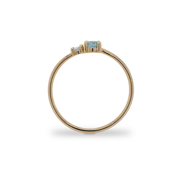 Load image into Gallery viewer, Side view of round cut blue zircon and diamond ring cast in 14 kt yellow gold.