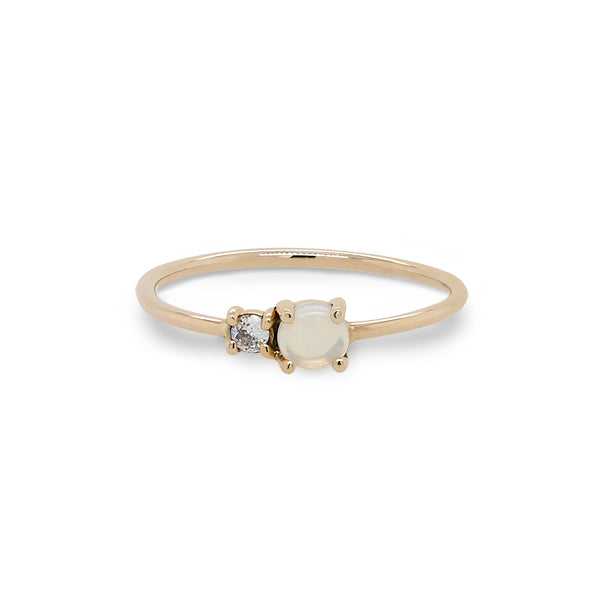 Front view of petite moonstone and round diamond ring set in 14 kt yellow gold.