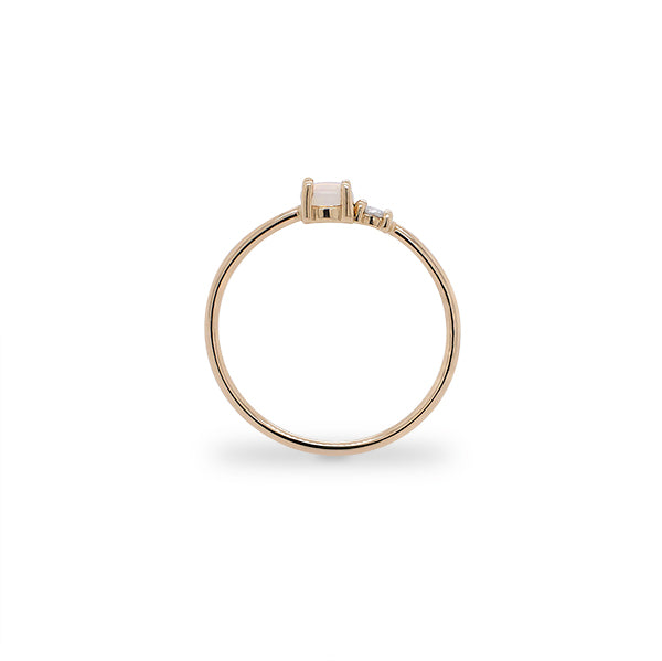 Load image into Gallery viewer, Side view of petite moonstone and round diamond ring set in 14 kt yellow gold.
