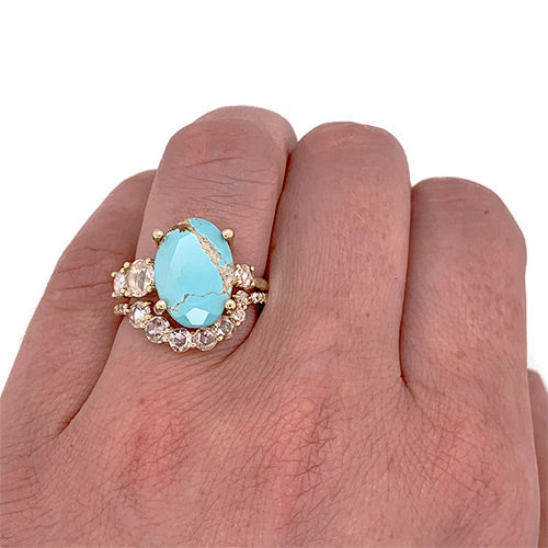 Rose cut turquoise and diamond ring cast in 14 kt yellow gold on left ring finger.