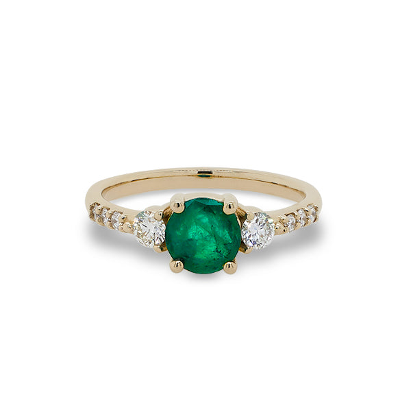 Front view of round emerald ring with 2 medium and 6 small accent diamonds cast in 14 kt yellow gold.