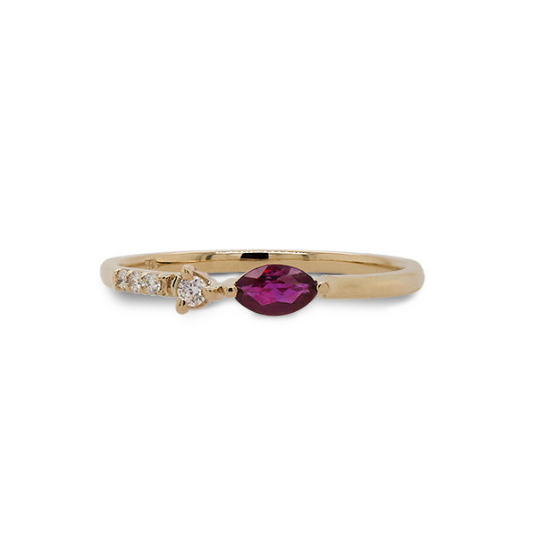 Front view of marquise cut ruby and diamond ring cast in 14 kt yellow gold.