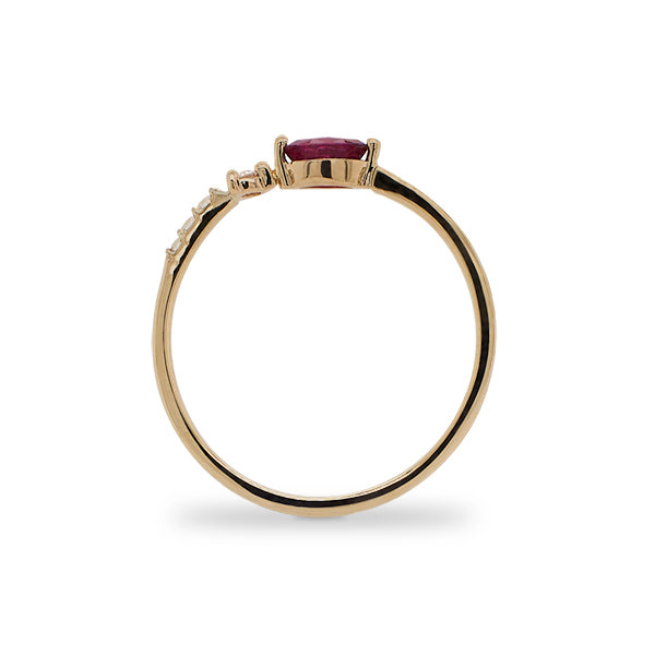 Side view of marquise cut ruby and diamond ring cast in 14 kt yellow gold.