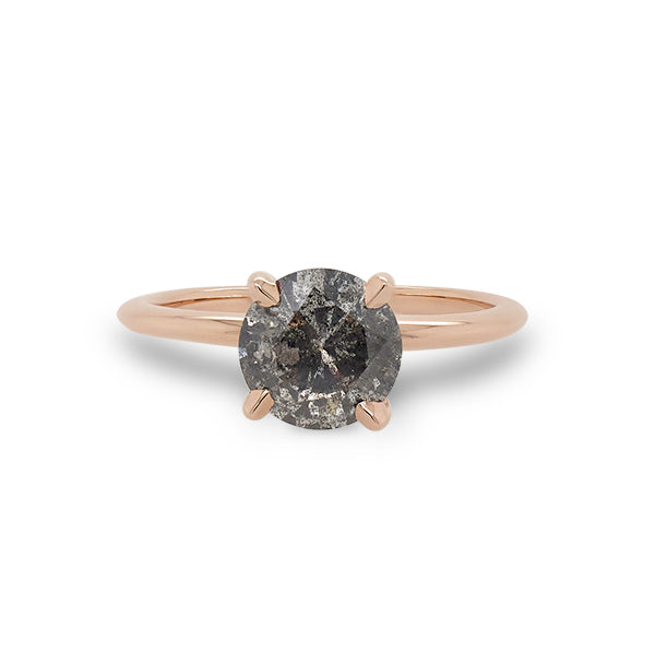Front view of 1.46 ct salt and pepper diamond solitaire band cast in 14 kt rose gold.