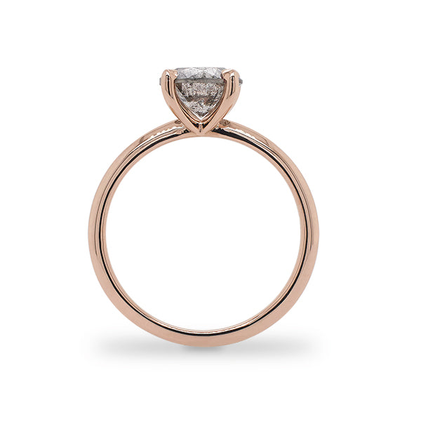 Side view of 1.46 ct salt and pepper diamond solitaire band cast in 14 kt rose gold.