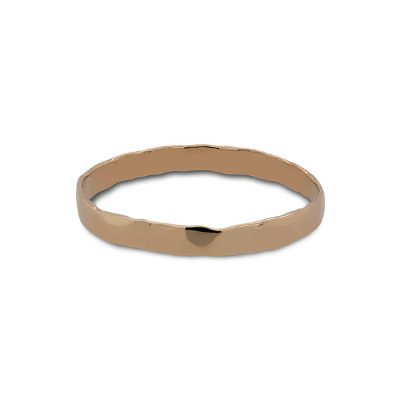 Front view of hammered stacking band cast in 14 kt yellow gold.