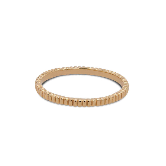 Front view of ring with a lined pattern cast in 14 kt yellow gold.