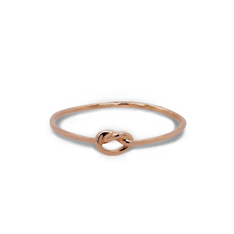 Front view of small stacking band with a center knot casted in 14 kt rose gold