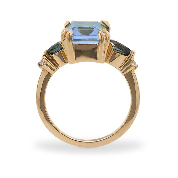 Load image into Gallery viewer, Side view of a large, emerald cut topaz, tourmaline and diamond ring cast in 14 kt yellow gold.