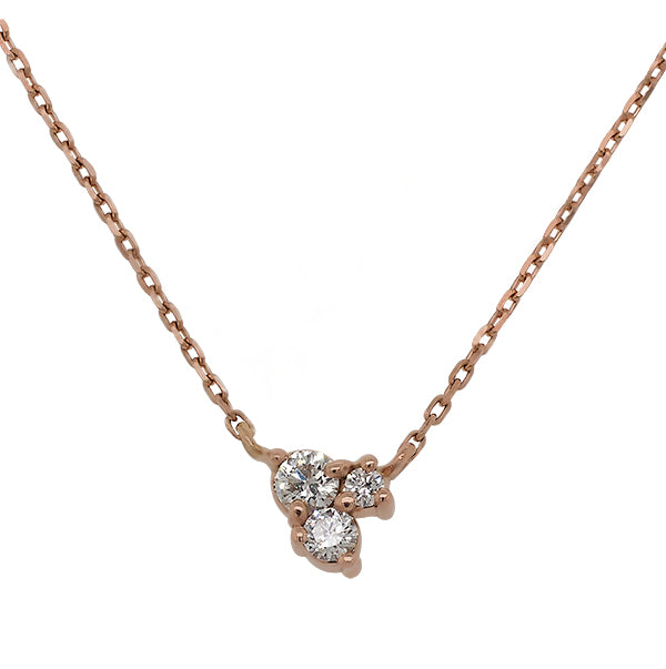 Front view of triple cluster diamond necklace set in 14 kt rose gold.