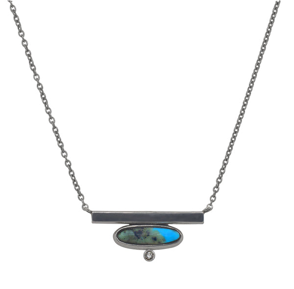 Front view of oval cut turquoise and round cut diamond bar necklace cast in 14 kt white gold.