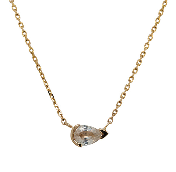 Front view of a pear cut white sapphire pendant necklace cast in 14 kt yellow gold.
