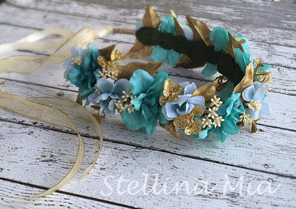 Stellina Mia Aqua, Blue, and Gold Ariel Floral Halo available for rent from The Borrowed Boutique.