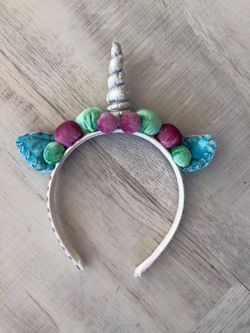 Silver Unicorn Headband with Mint Blue and Purple available for rent from The Borrowed Boutique.