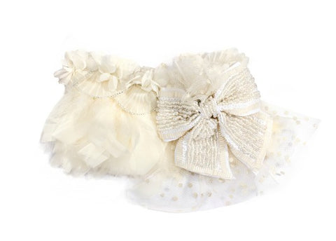 Modern Queen Kids Magical Feathers Collar in Ivory with luxe sparkling beaded bow and ivory polka dot tulle detail.