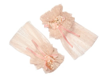 Modern Queen Kids Pretty Party girl's cuffs in blush. Features fluffy layers of tulle, exquisite beading detail, and fanciful velvet bow.