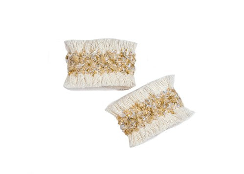 Modern Queen Kids Sparkle and Light girl's cuffs in ivory with ivory soft fringe and sparkling metallic trim detail.