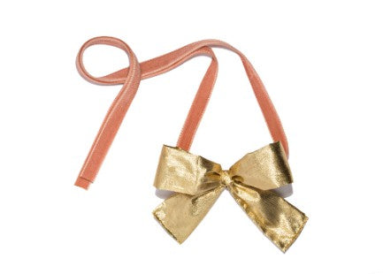 Modern Queen Kids Golden Beauty girl's gold necklace with a shimmering metallic gold bow and the softest, blush double faced velvet ribbon.