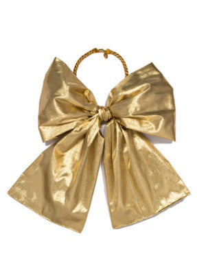 Modern Queen Kids Grande Party Bow Necklace In Gold with soft twisted cable rope and luxe gold metallic bow.
