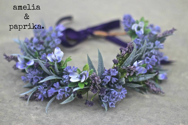 Amelia and Paprika lush flower halo filled with vibrant lavender flowers and greenery. Custom made for our shop and adjustable in size due to the tie back ribbons. One size fits most.