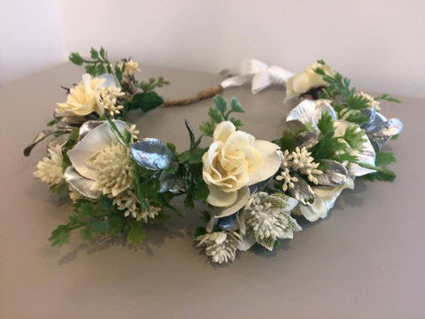 A lush Amelia and Paprika halo filled with elegant cream and silver flowers and greenery. Custom made for our shop and adjustable in size due to the tie back ribbons. One size fits most.