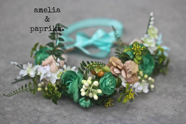 Amelia and Paprika halo filled with soft minty green flowers and greenery. Custom made for our shop and adjustable in size due to the tie back ribbons. One size fits most.