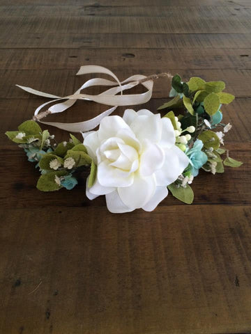 Amelia and Paprika lush halo filled with mint green and white flowers and greenery. Custom made for our shop and adjustable in size due to the tie back ribbons. One size fits most.