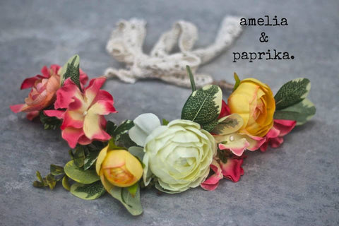 Amelia and Paprika lush flower halo filled with vibrant yellow, cream and peachy pink flowers and greenery. Custom made for our shop and adjustable in size due to the tie back ribbons. One size fits most.