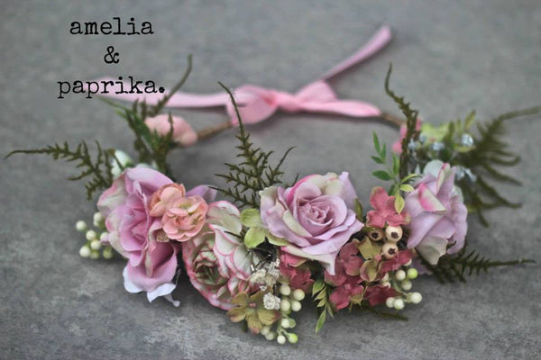 Amelia and Paprika lush flower halo filled with soft pinkish purple flowers and greenery. Custom made for our shop and adjustable in size due to the tie back ribbons. One size fits most.