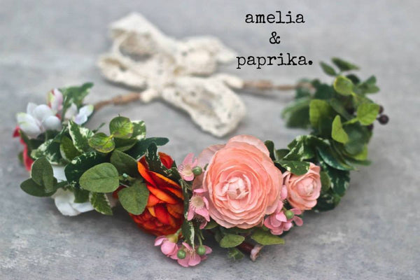 Amelia and Paprika lush flower halo filled with vibrant peach and rusty orange flowers and greenery. Custom made for our shop and adjustable in size due to the tie back ribbons. One size fits most.