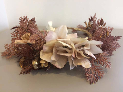 Amelia and Paprika lush flower halo filled with rose gold accents and pops of true gold and soft pink. Custom made for our shop and adjustable in size due to the tie back ribbons. One size fits most.