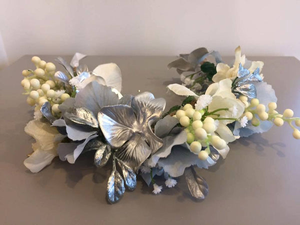 Amelia and Paprika flower halo filled with silver and cream flowers. Custom made for our shop and adjustable in size due to the tie back ribbons. One size fits most.