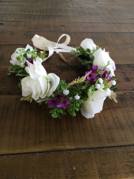 Amelia and Paprika flower halo filled with vibrant white and purple flowers and greenery. Custom made for our shop and adjustable in size due to the tie back ribbons. One size fits most.